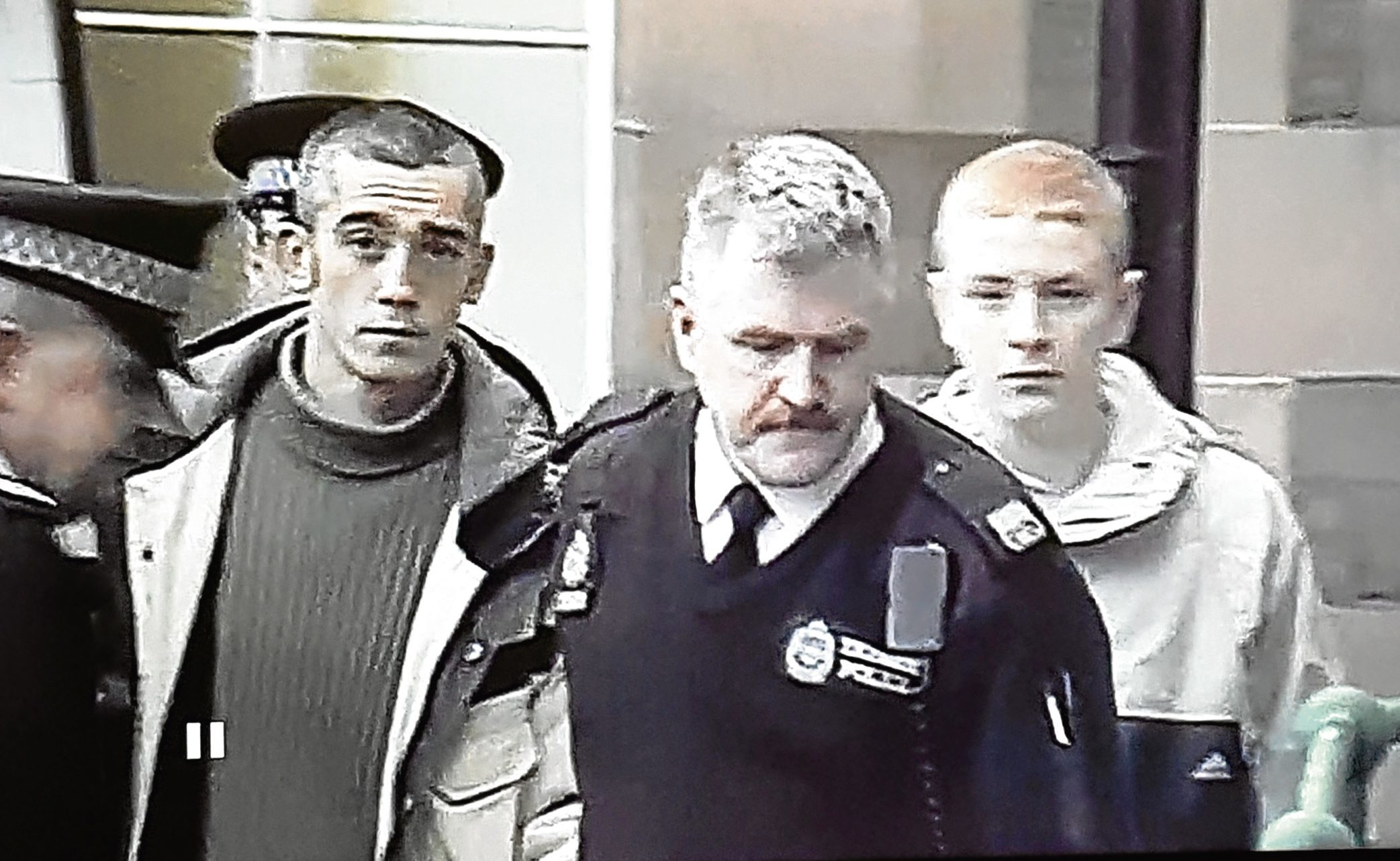 Robert Stratton, left, and Robbie McIntosh pictured being led away in 2002.