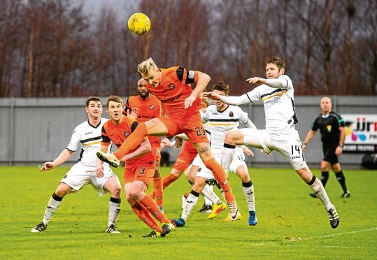 "Dundee United's Nick van der Velden attacks the goal during their 1-0 defeat at Dumbarton last December. ""Holtie"" says the Tangerines will need to scrap for every win, starting against The Sons."