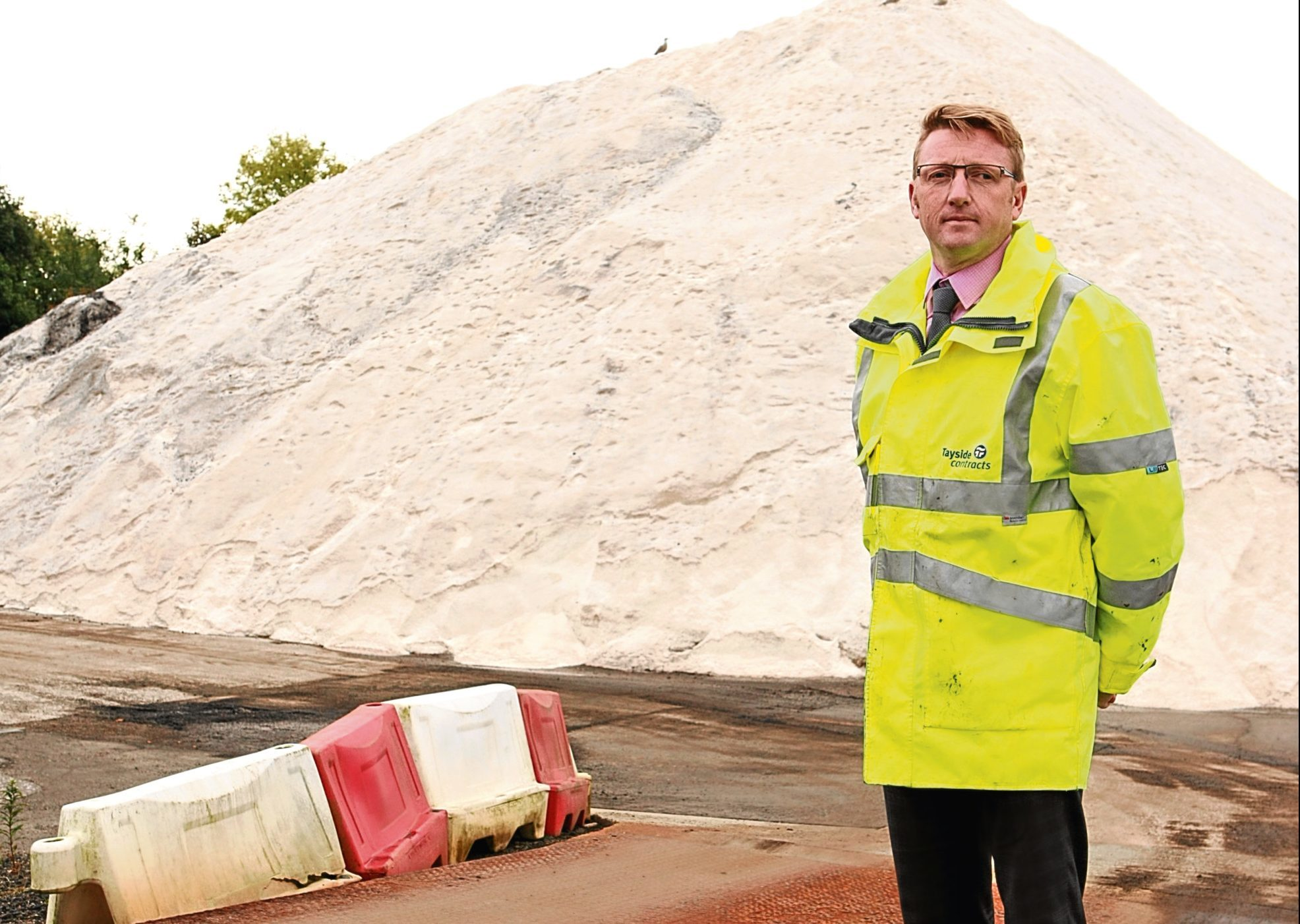 Dougie McKay, head of roads maintenance, pictured at the salt mountain at Marchbanks.