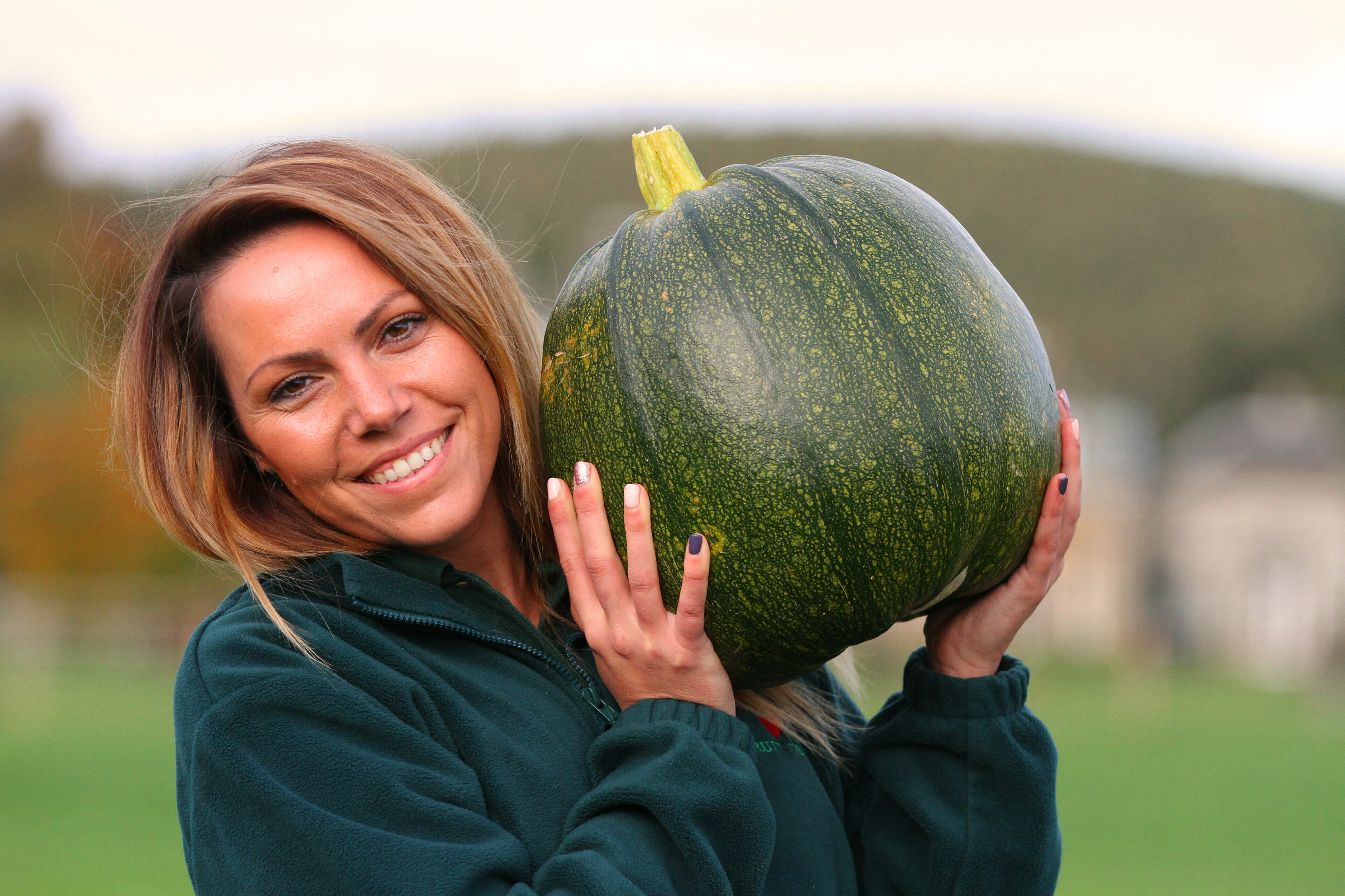 Cairnie Fruit Farm assistant Silvia Moldovan with one of the green pumpkins.