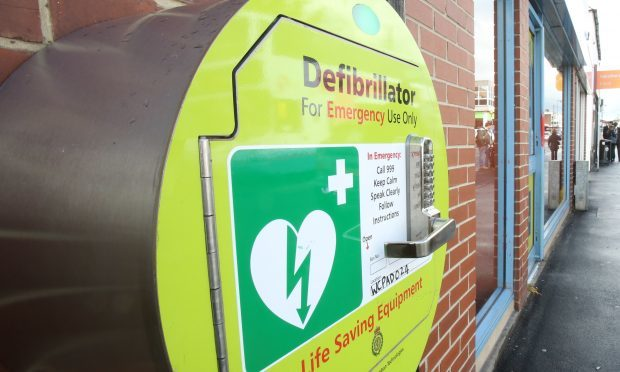 An emergency defibrillator on a wall. (library picture)