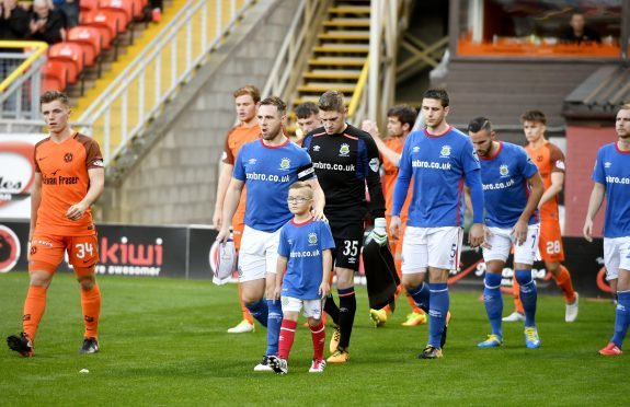 Linfield fans have said offensive songs during the Dundee United clash were from Rangers supporters.