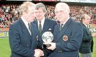 Dundee United manager Jim McLean (right) receives an award after his last game in charge.