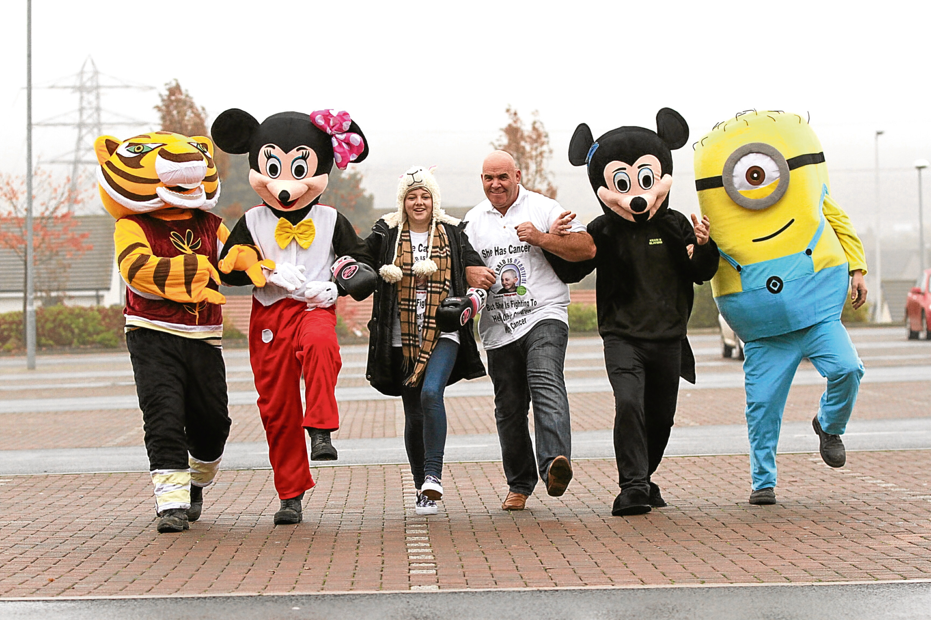 Charlie with cancer survivor Megan Fletcher joined by Tigress, Minnie and Mickey Mouse and a Minion, in the lead-up to a previous year's event