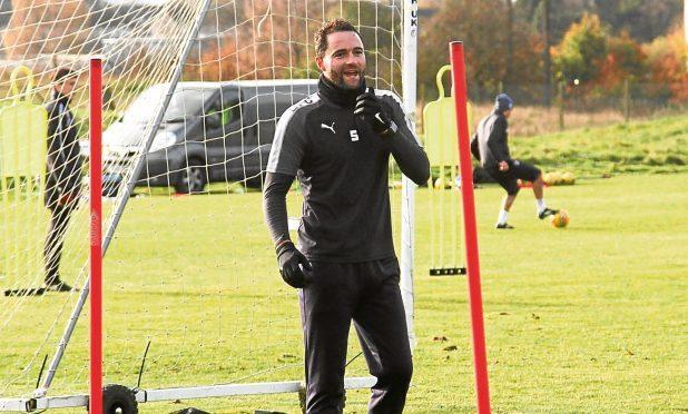 Dundee's James McPake returns to training