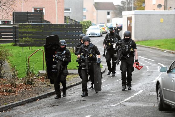 Police activity at the incident in Yarrow Terrace, Menzieshill