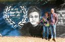 Lesley Nicoll and Phil Welsh — the parents of Lee Welsh — next to a mural in his memory.