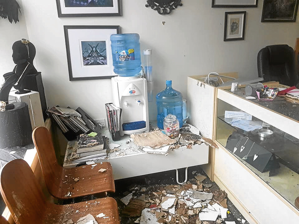 Debris scattered around Liquorice Tattoo and Piercing Studio after a water-damaged ceiling collapsed.