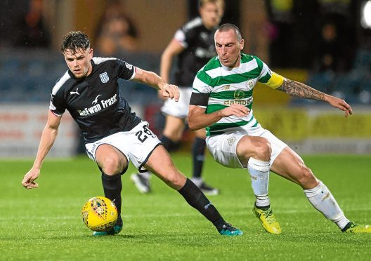 Dundee midfielder Lewis Spence — pictured above in Betfred Cup action against Celtic — will be going under the knife to sort an ankle injury.