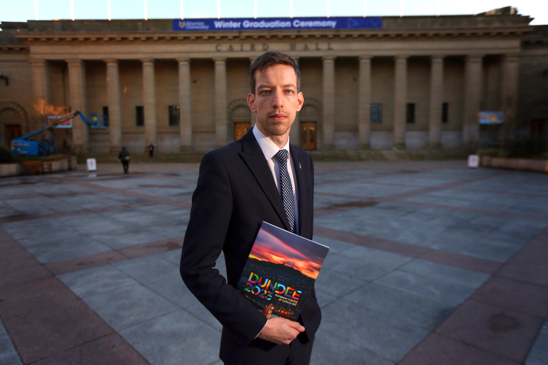 John Alexander, Leader of Dundee City Council, with the bid brochure
