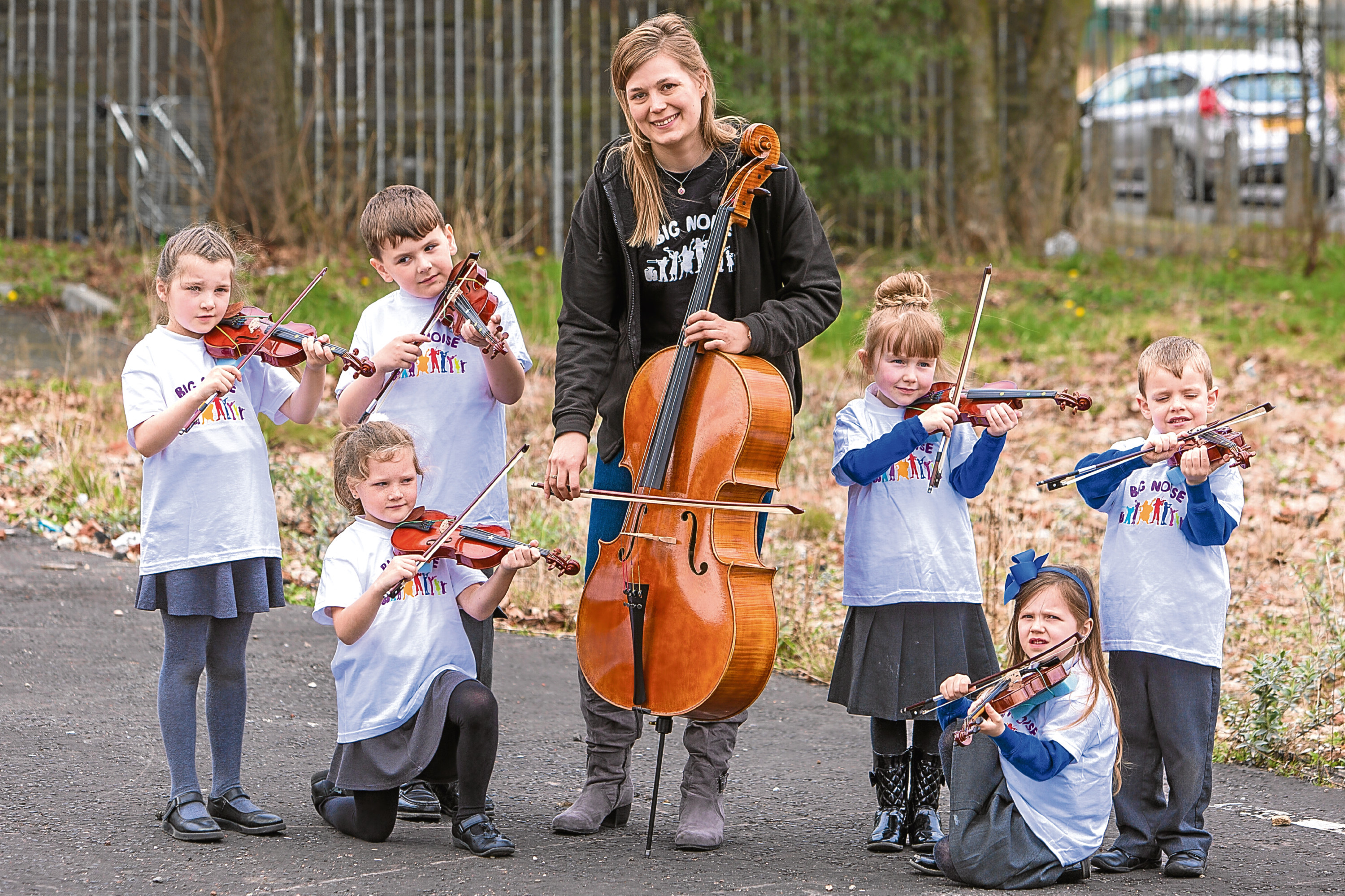 Kids from Claypotts and St Pius play violins with Chellist Jenni Harra. Kids: Caitlyn Bertie, Ryan MacKenzie, Amelia Souter, all Claypotts and Josie Mitchell, Peter Diamind, Maggie McGraw from St Pius