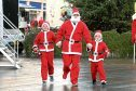 Participants in the inaugural Santa Dash fundraiser, which was held in the city to raise funds for the Archie Foundation.