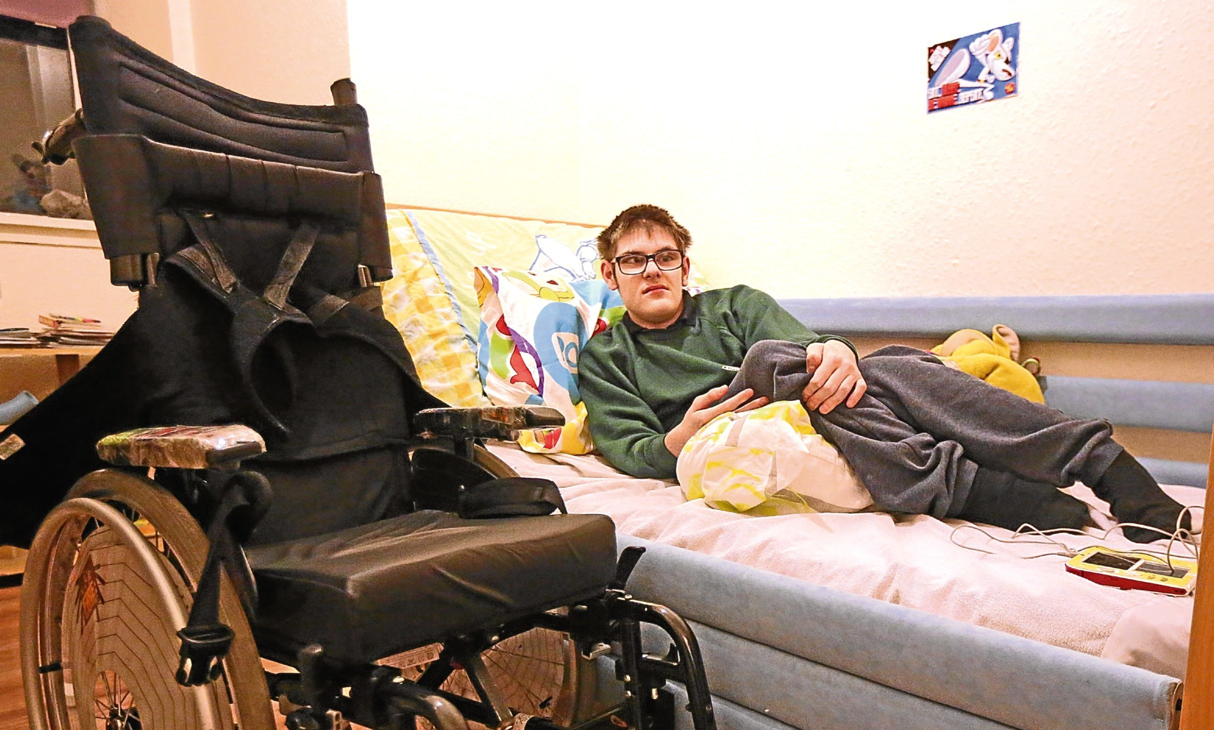 James Fordyce, 16, from Alyth, with his electric wheelchair
