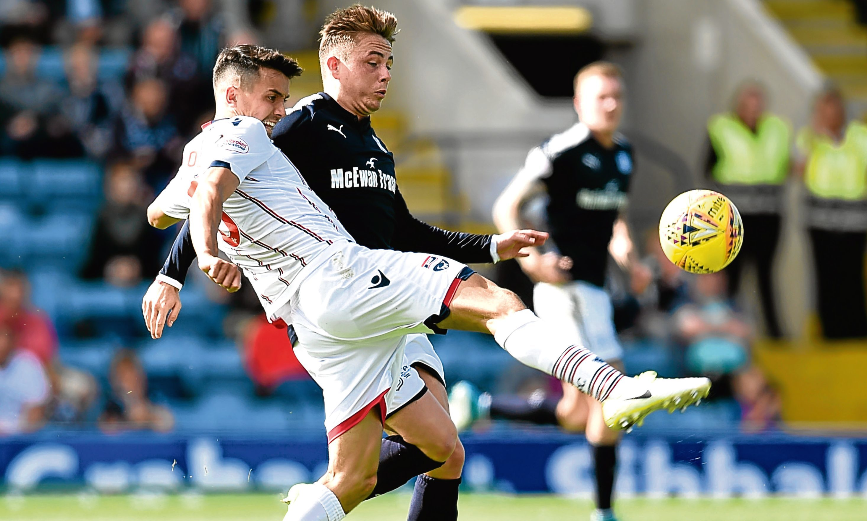 Ross County's Tim Chow (left) battles for the ball with Dundee's Scott Allan when the two sides met on the opening day