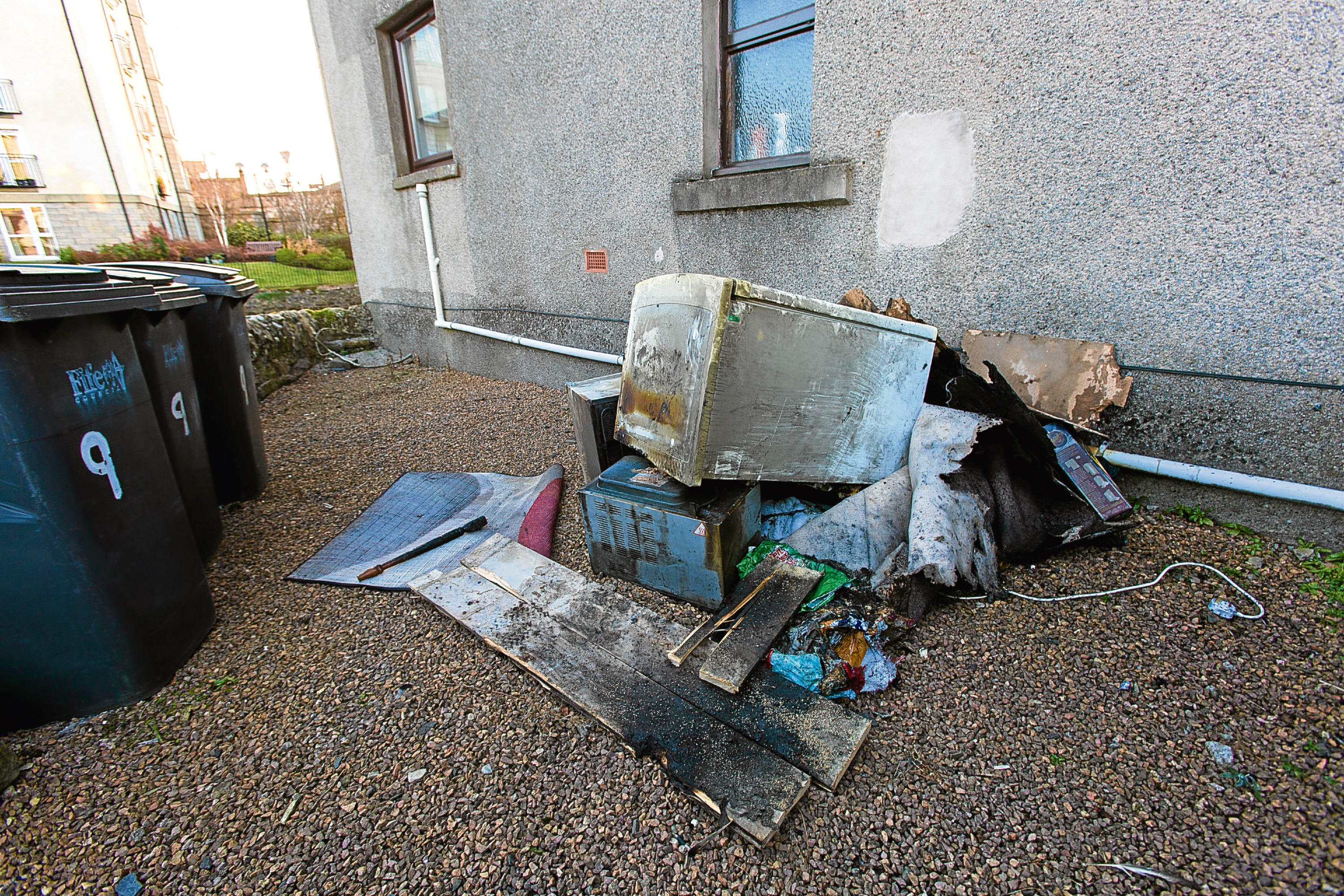 Damaged goods outside flat in Cupar where a man was taken to hospital