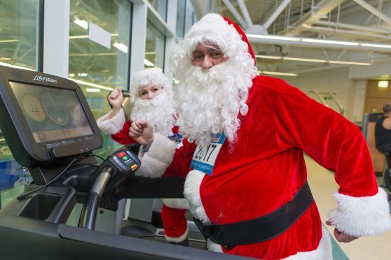 Two Santas hit the treadmills in preparation for Sunday's dash.