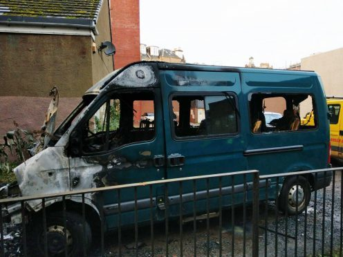One of the fire-ravaged minibuses.