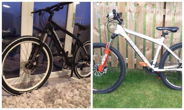 The stolen black Commencal and Carrerra Kracken mountain bikes