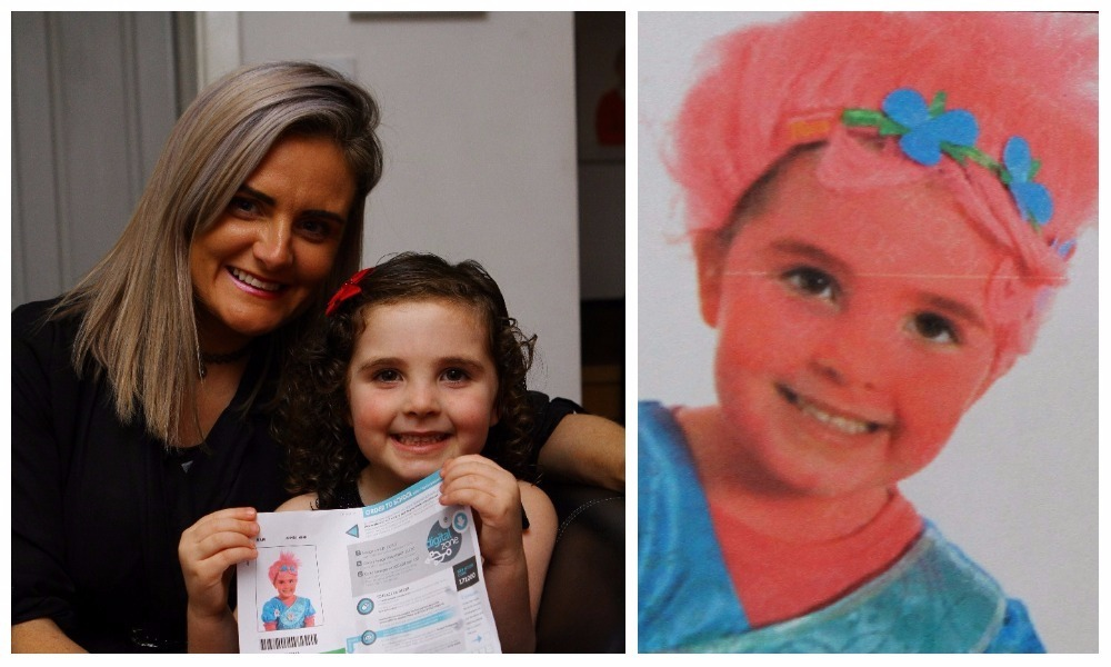 Scarlett Campbell with mum Lisa and a copy of the photo she had taken in her Halloween costume.