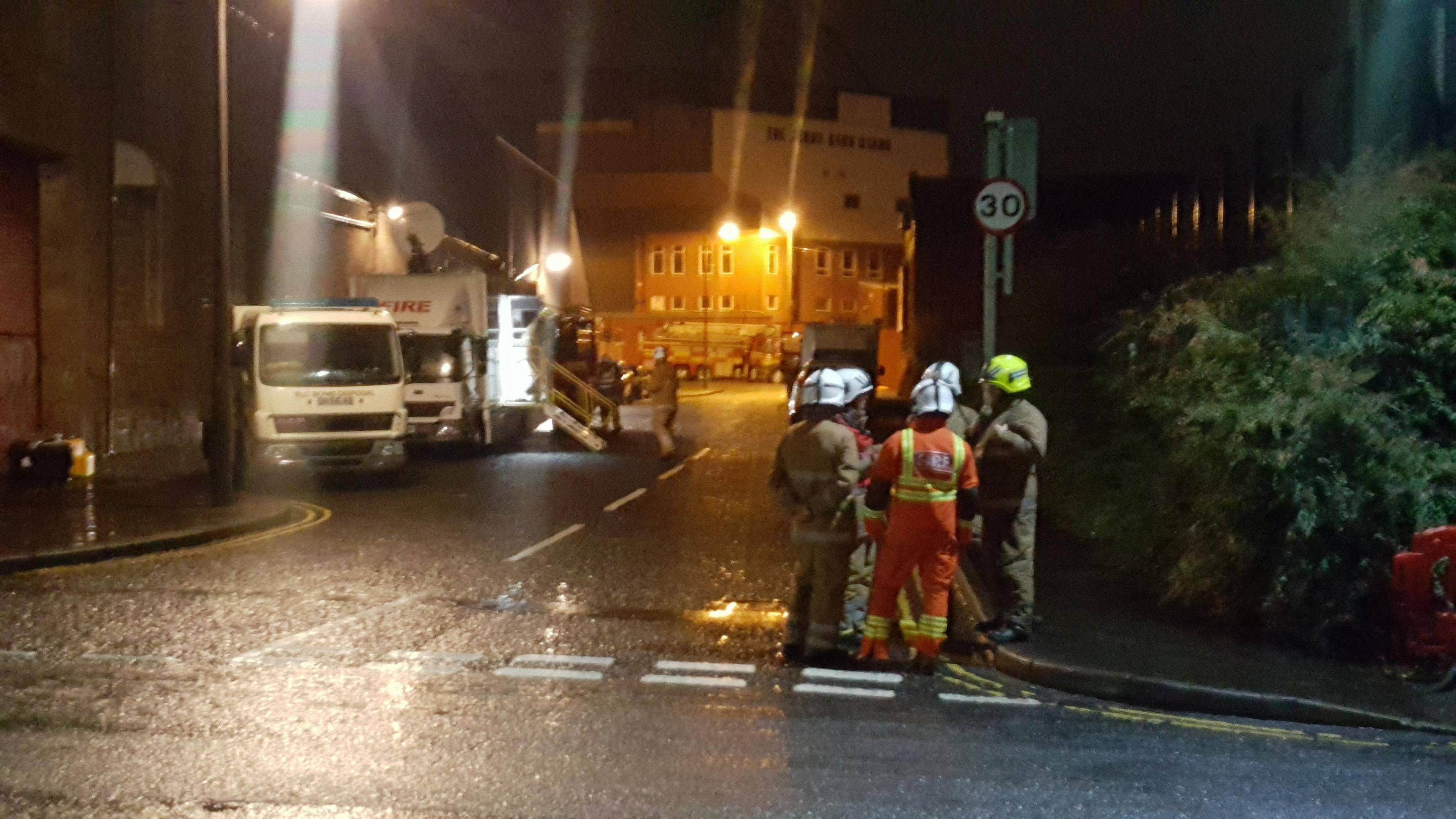 A bomb disposal unit parked on North Isla Street alongside a police and fire command unit.