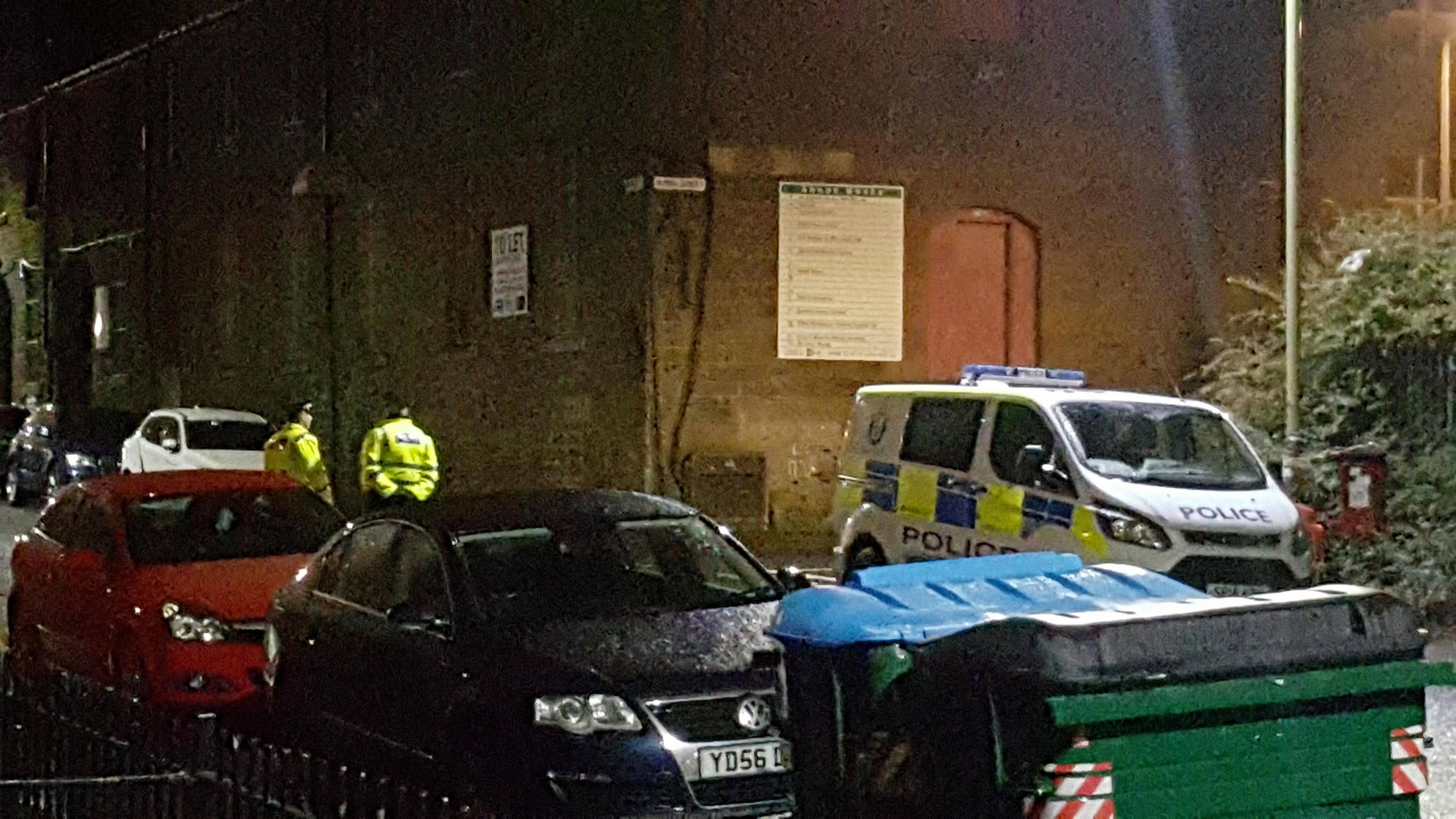 Police stand guard near the scene