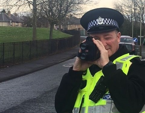 An officer with a speed camera
