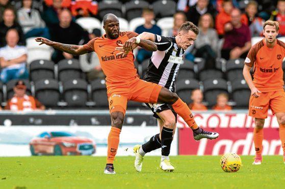 Dundee United's William Edjenguele (left) in action against Stephen McGinn