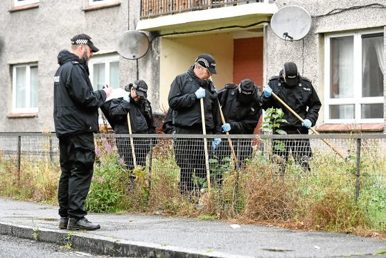 Police officers searching for evidence in Ballantrae Terrace, Dundee, after the incident