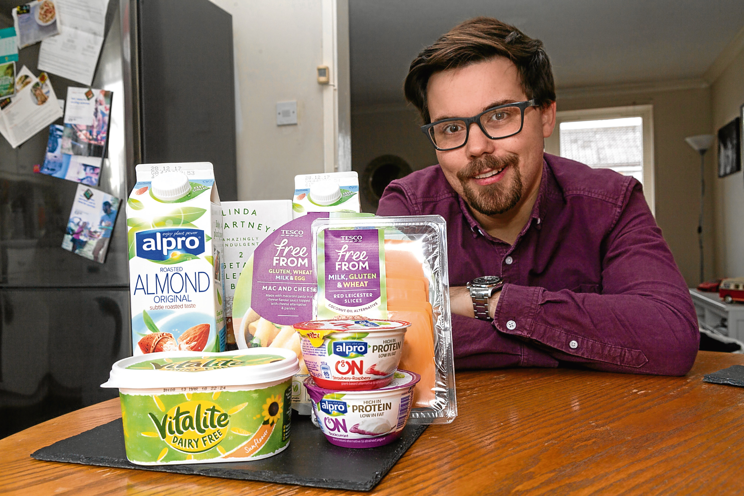 Jon with some vegan food products