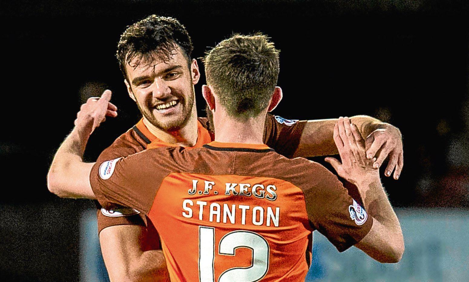 Scott Fraser (left) celebrates his goal with Sam Stanton