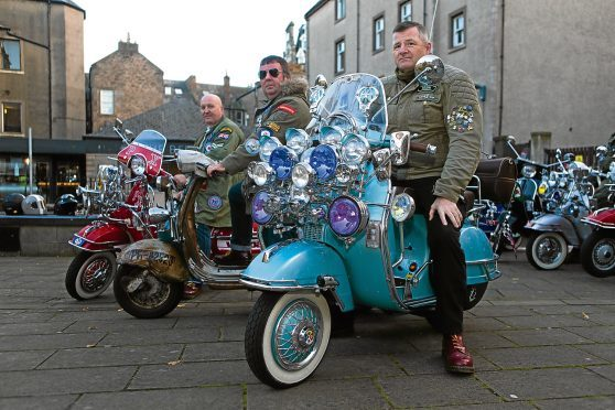 Mark Griffiths (48) with his 2012 Scooter, Arthur Hayburn (59) with his 1964 Scooter and Bob Stephens (53) with the 70th anniversary 2017 model scooter