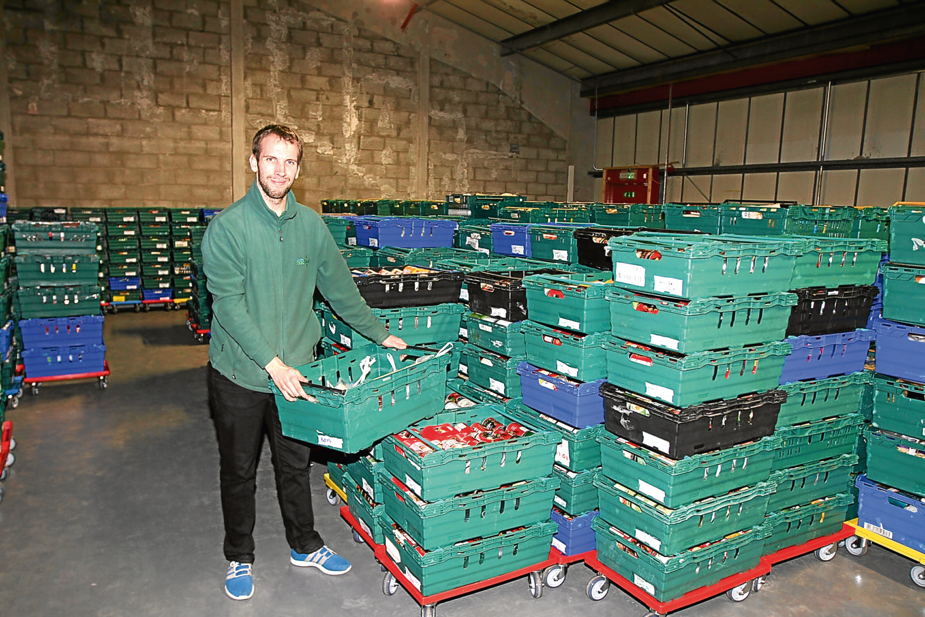 Michael Calder in the warehouse of the Foodbank HQ in Dunsinane Avenue