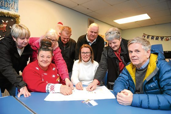 The new group with (right, seated) Councillor Charlie Malone at Dryburgh Community Centre
