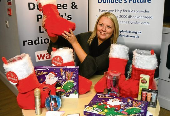 Stacey Wallace, charity manager for Help for Kids, with some of the Christmas stockings.