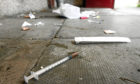 Drugs paraphernalia strewn in a close in Dundee.