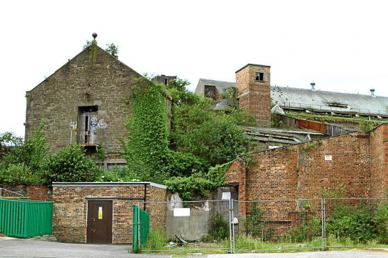 General view of the dilapidated state of the former Queen Victoria Works near Brook Street in Dundee.