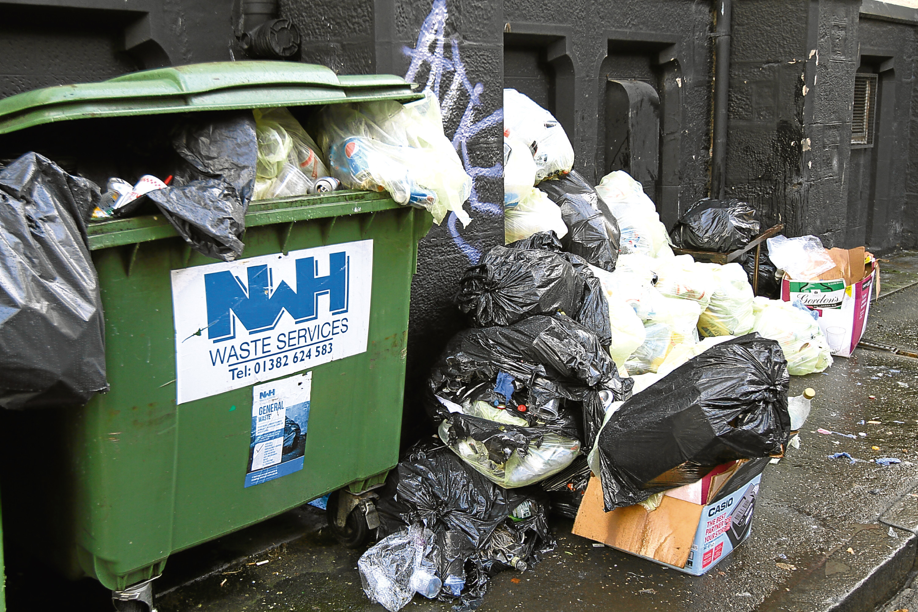 Rubbish piled up in Rattray Street