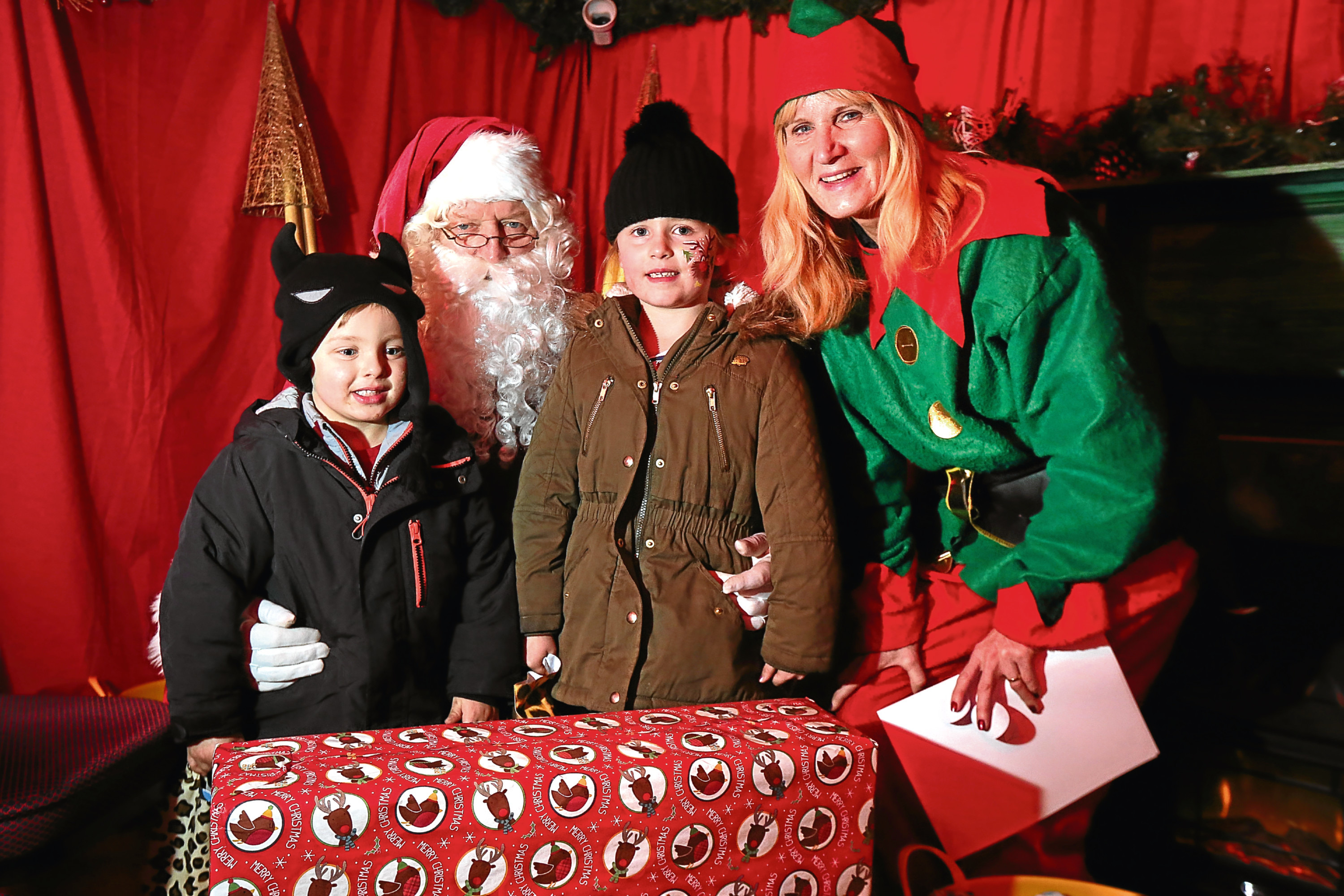 Noah and Alba Cooper with Santa and his elf.