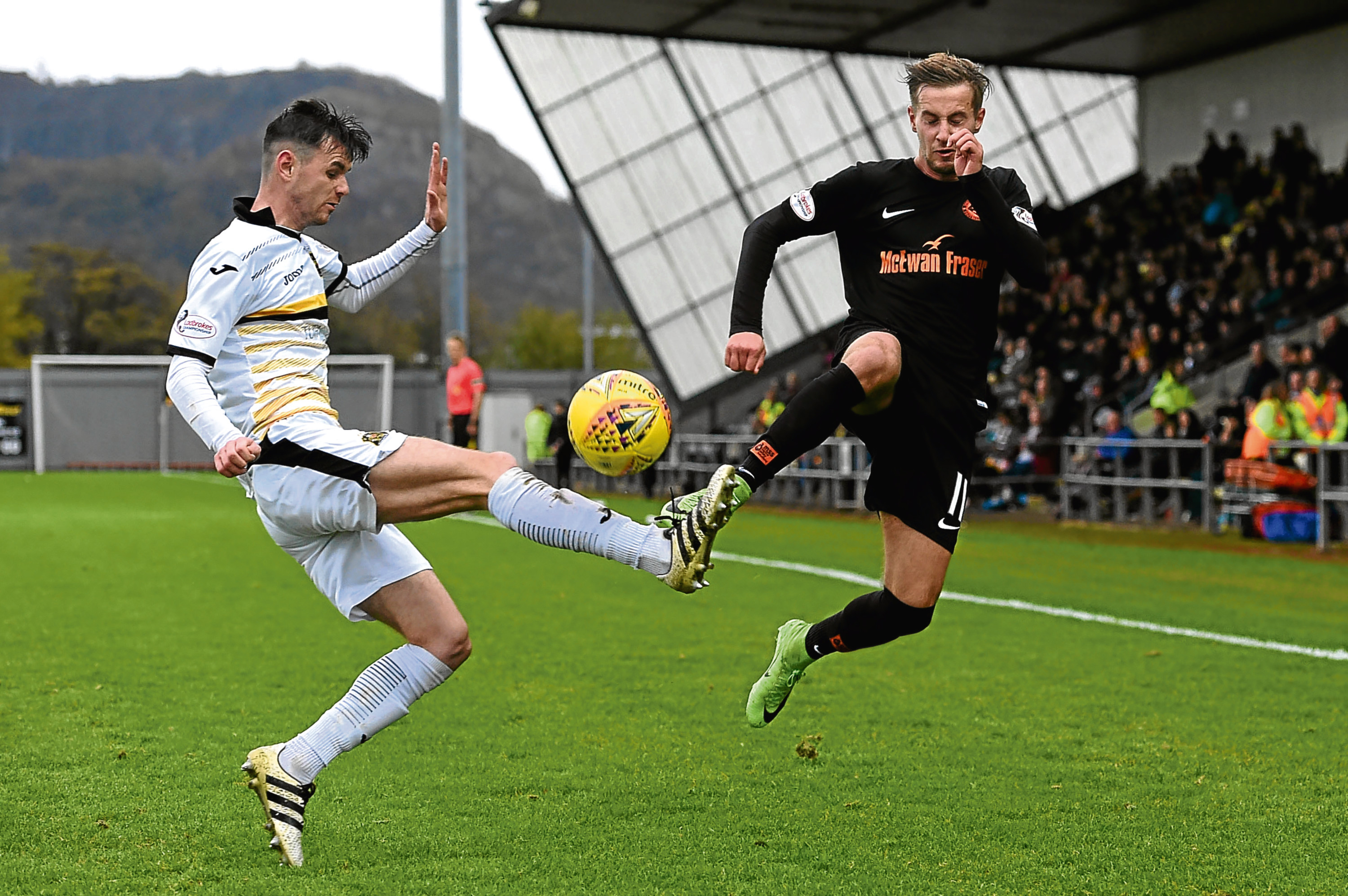 Billy King (right) — pictured in action against Dumbarton — is eager to avenge Dundee United's shock defeat to this weekend's visitors Livingston when the sides meet at Tannadice.
