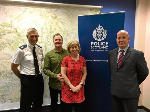 Pictured are Chief Supt Anderson, Linda, her husband Matthew and Detective Inspector Tom Leonard.