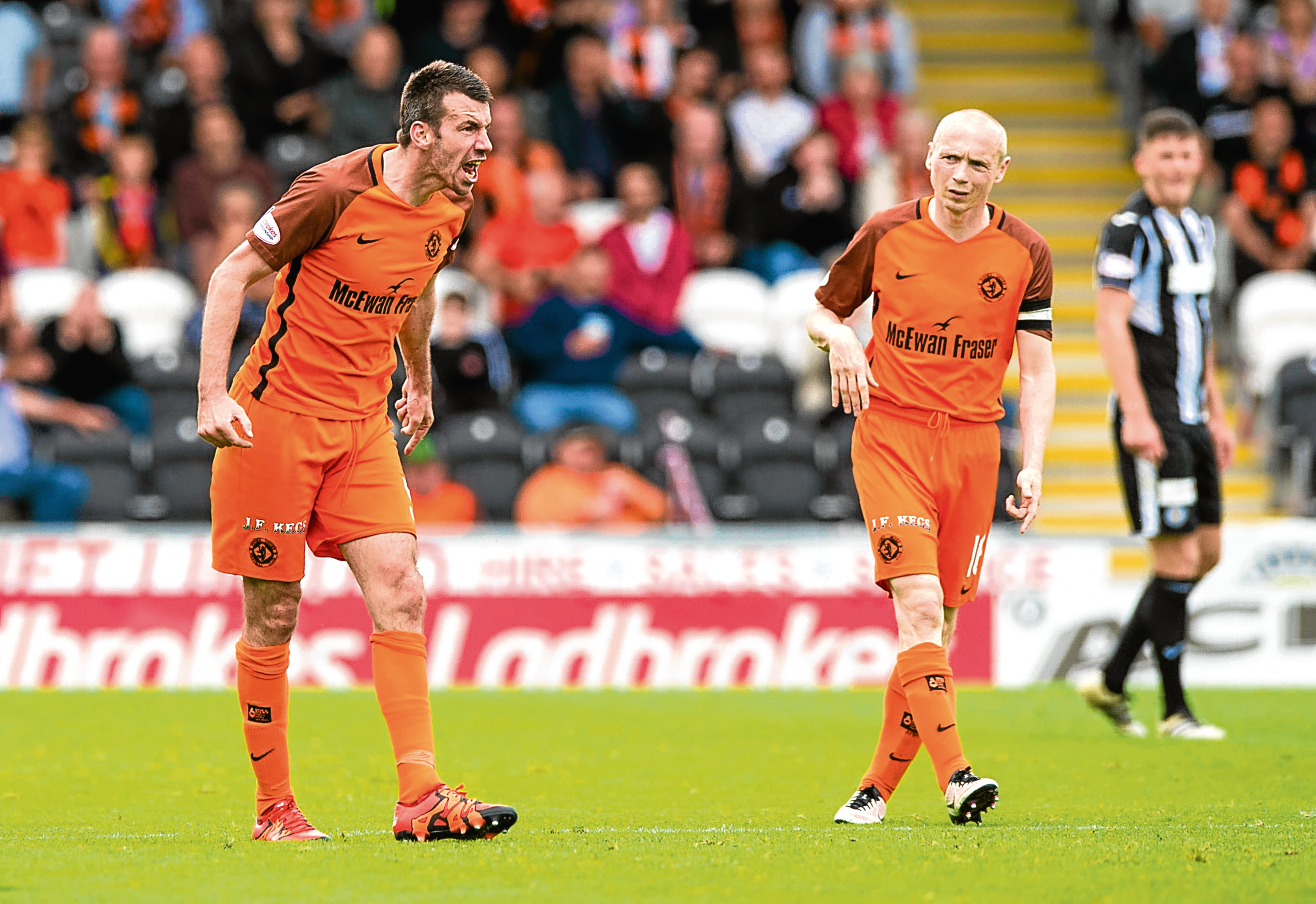 Dundee United's Paul Quinn vents his frustration