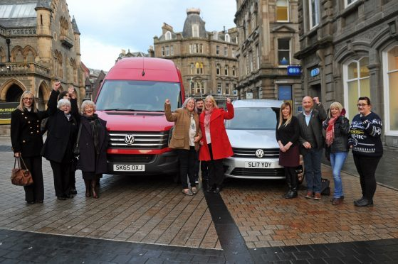 Euromillions winner Gillian Bayford donates a minibus and van to Inclusion Group.
