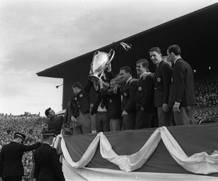 The victorious Celtic team hold aloft the European Cup after their 1967 win. A play will chart their success.