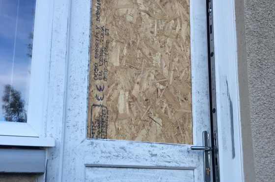 The damaged back door at the Crail Place home