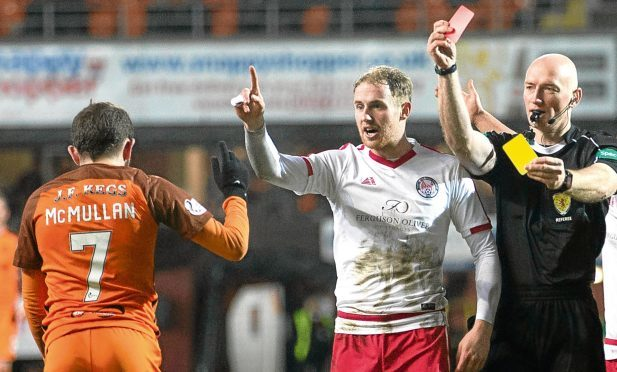 Dundee United's Paul McMullan is sent off for simulation by referee Alan Newlands
