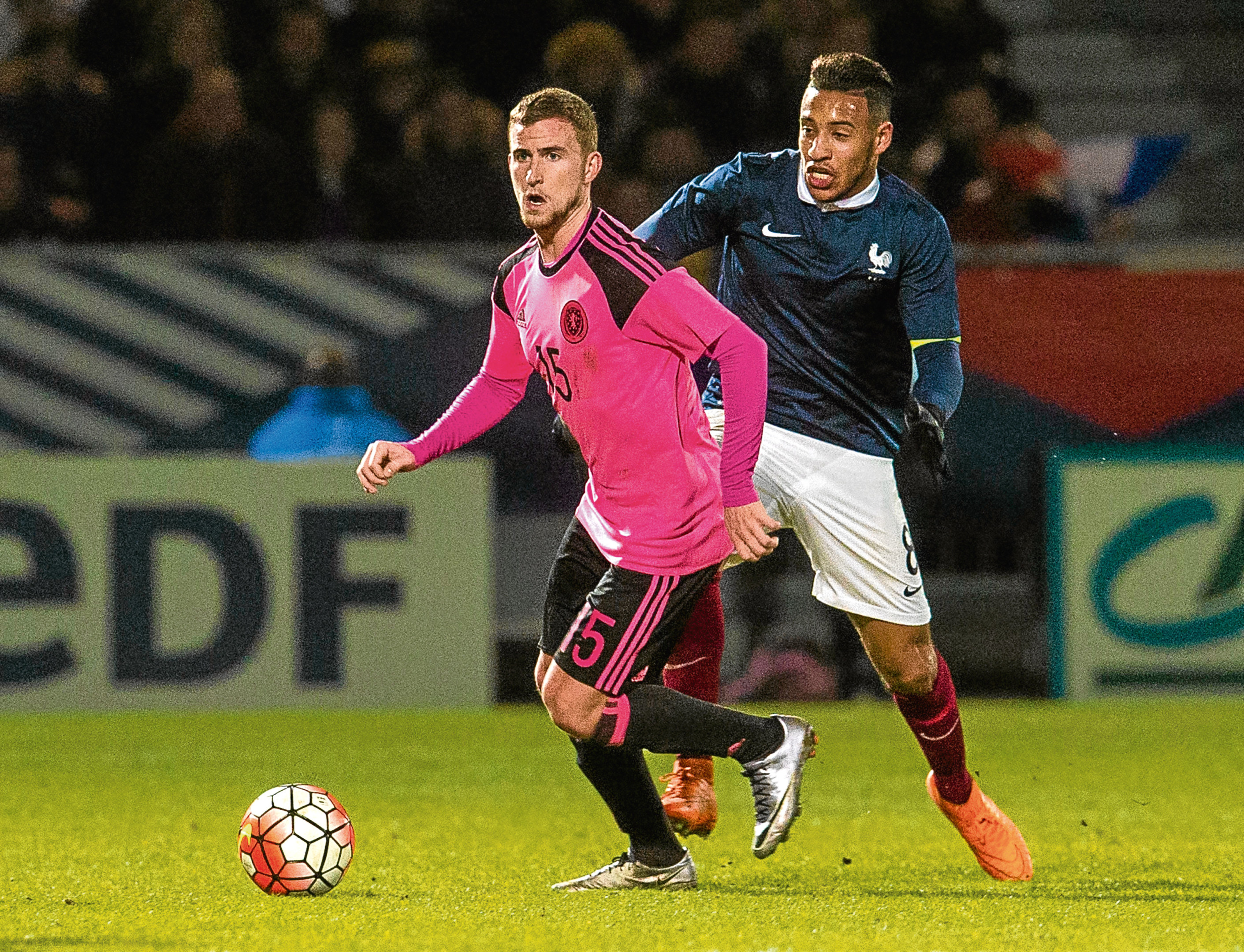 Craig Slater, pictured in action for Scotland U/21s, has signed for Dundee United on loan from Colchester United until the end of the season.