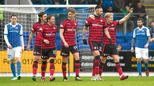 Dundee finished up for the winter break with a 2-0 away win over St Johnstone last Saturday. Marcus Haber (second right) celebrates his goal.