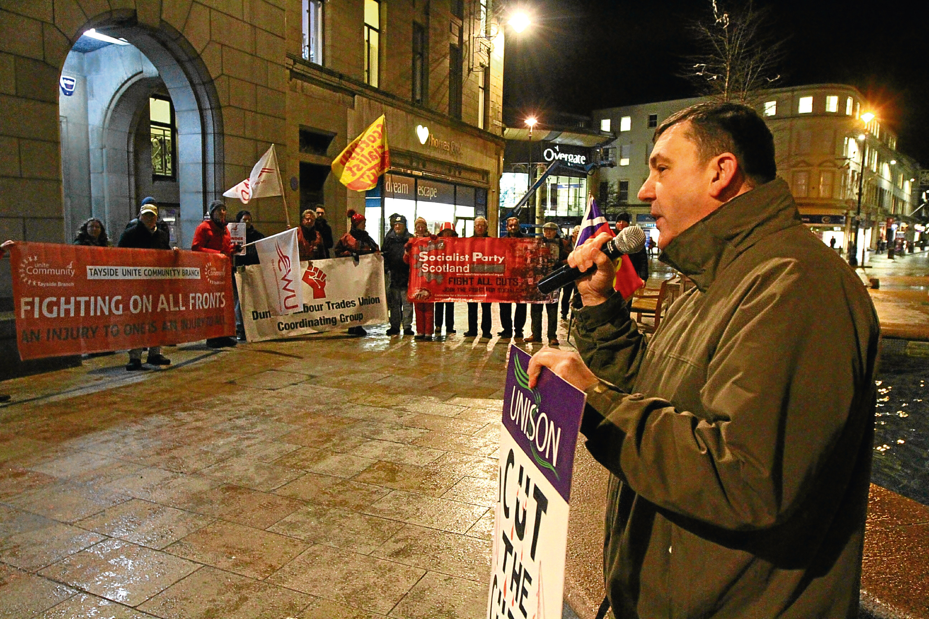 Jim McFarlane, Dundee's Unison branch secretary, addresses protesters in City Square ahead of the budget meeting.