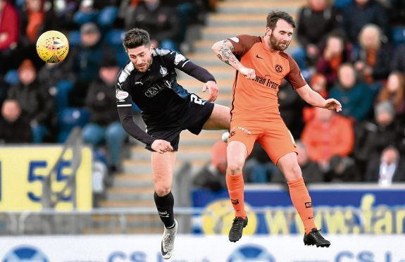 Dundee United's James Keatings challenges Falkirk's Lewis Kidd in their 6-1 loss to the Bairns on Saturday.
