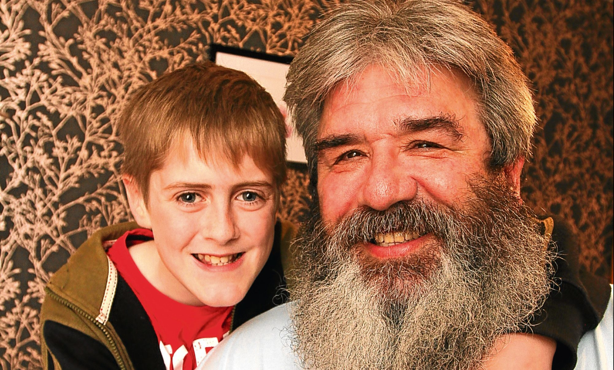 Nathan with his grandad Nick (55), who has been growing a beard to raise money